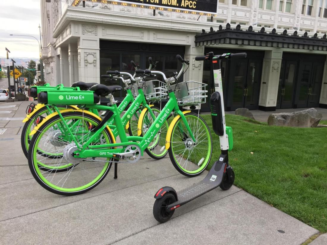 Lime bikes and scooter in front of Pantages Theater